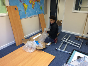 Mr Loadlink junior helping assemble desks