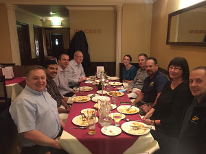 Straightpoint Inc. general manager John Molidor (centre of right row) enjoys a meal with the UK team during his recent visit.