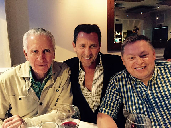 Enjoying a meal with Steve Torres, ?CEO at Group Four? Transducers Inc., (centre) and his father, Sidney.